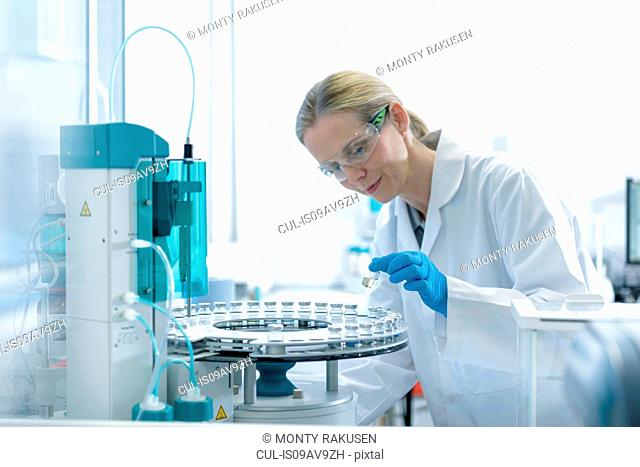 Female scientist with oil sample in testing facility