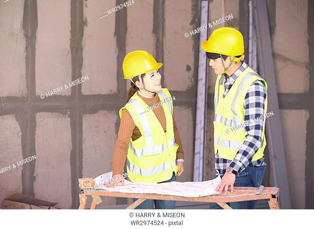 Construction workers face to face
