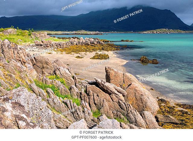 BLUE LAGOON IN THE BAY OF VESTFJORD, GRADVAL, LOFOTEN ISLANDS, NORWAY