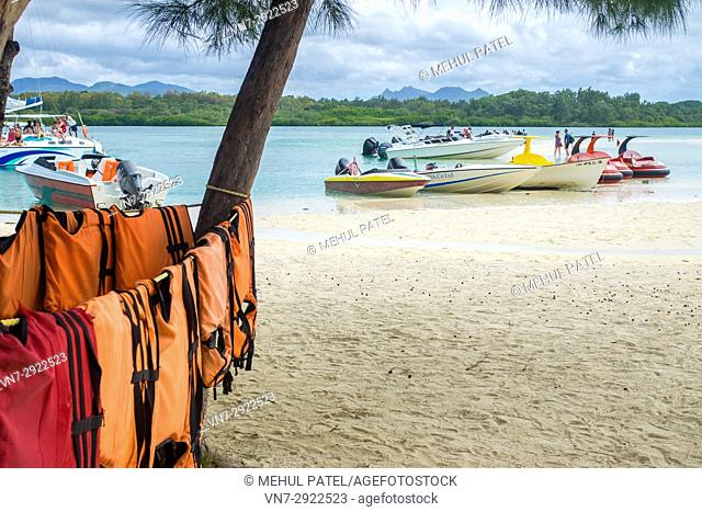 Life jackets hanging out to dry around a tree on the island of Île aux Cerfs, Mauritius, Indian Ocean. Île aux Cerfs is a privately owned island near the east...