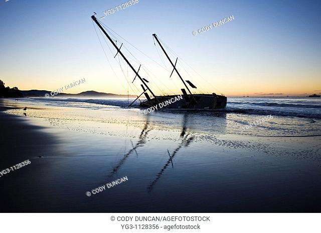 Santa Barbara, California: Sailboat washed ashore on beach during winter storm