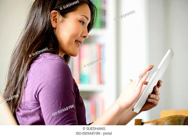 Close up of woman using digital tablet