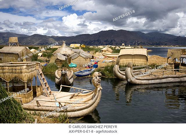 Uros Islands with totora boats in Lake Titicaca, Peru and Bolivia