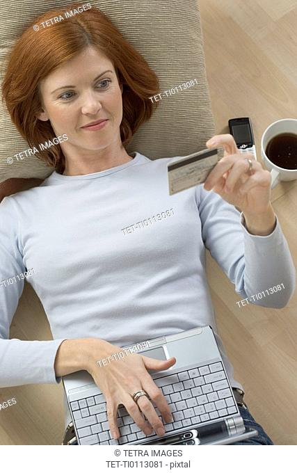 Woman with computer and credit card