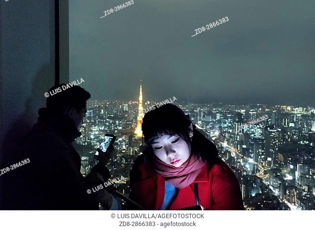 Girl take a selfie in skyline from Roppongi Tower. Japan. Tokyo