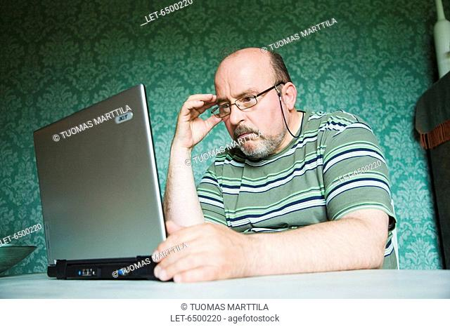 Middle-aged man with laptop computer  Finland