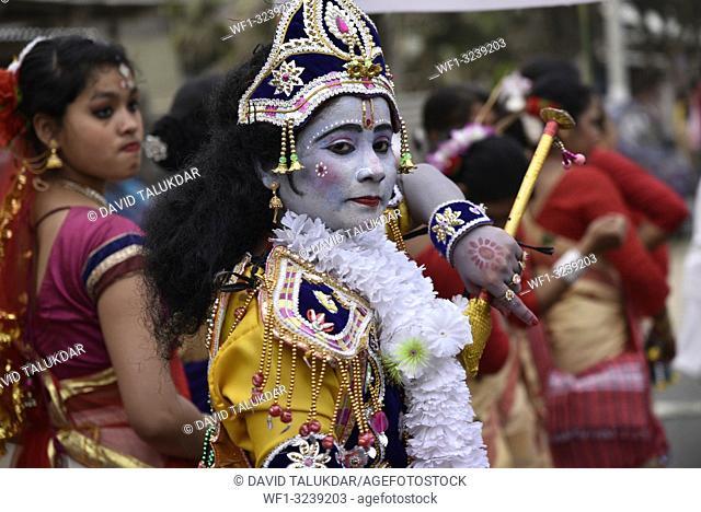 Marigaon, Assam, India. 8 Feb. 2019. Devotee dressed up like Lord Shri Krishna in a cultural rally during 88th session of Srimanta Sankardev Sangha Adhibeshan