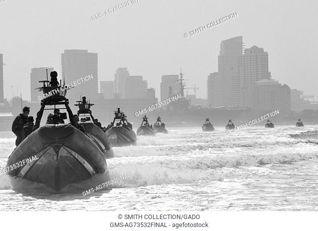 Rigid-hull inflatable boats carry Special Boat Team SBT 12 Sailors and guests through San Diego Bay to an at-sea change of command, San Diego, California, 2012