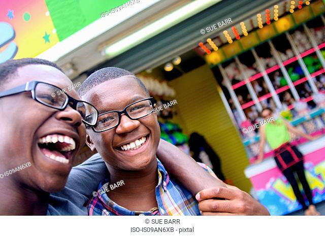 Portrait of teenage boys laughing at amusement park
