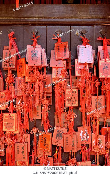 Red Chinese envelopes tied to wall