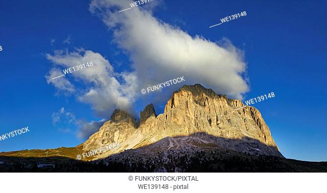 Sassolungo Mountain range, 3081m high, from the Sulla Pass between the Val Gardena and Val di Fassa, the Western Dolomites, Southern Tyrol; Trentino, Italy