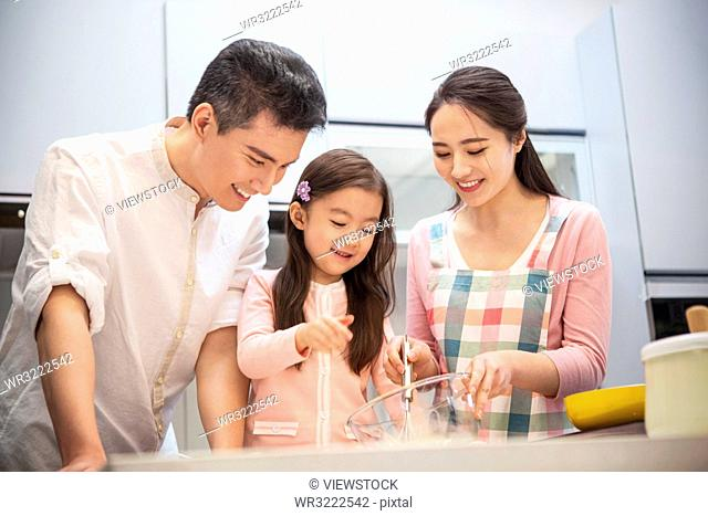 A happy family in the kitchen
