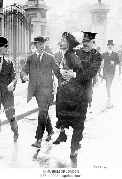 Emmeline Pankhurst arrested by Superintendent Rolfe outside Buckingham Palace, London, May 1914. Mrs Pankhurst was trying to present a petition to the king