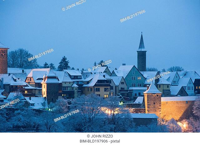 Quaint, snow covered village at night