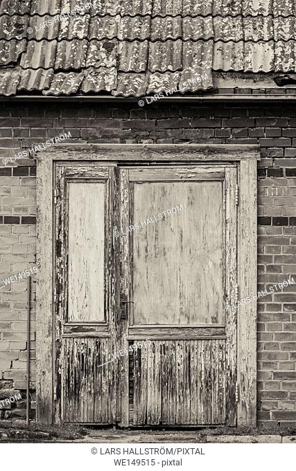 Closed door of old abandoned building. Vintage house front. Grungy architecture