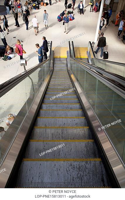 England, London, Waterloo Station. View down unoccupied escalator