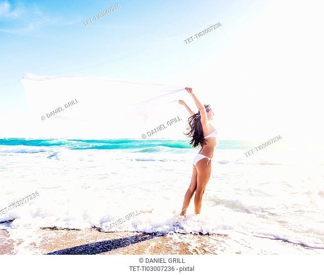 Woman in white bikini on beach