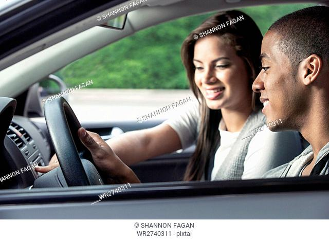 Teenagers driving car