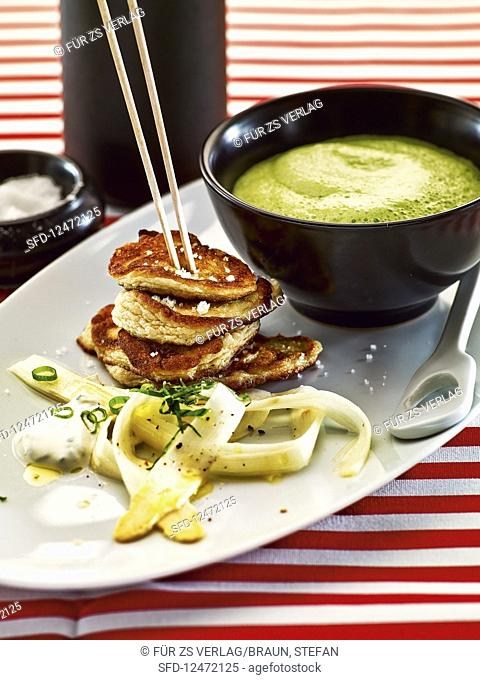 Blinis with marinated asparagus and herb foam soup