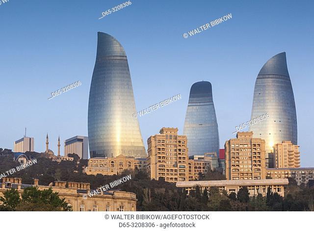 Azerbaijan, Baku, city skyline with Flame Towers form Baku Bay, dawn