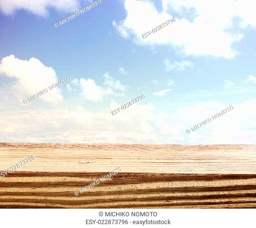 Blue sky with a wooden board foreground