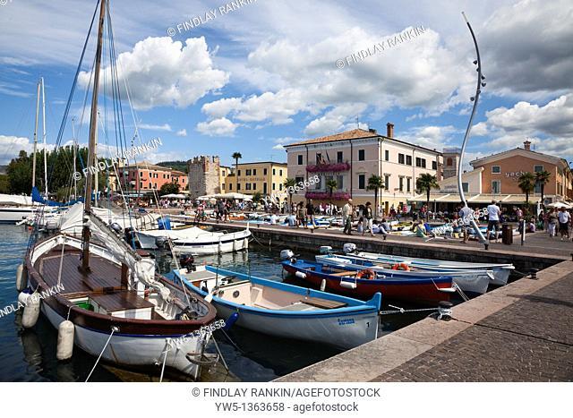 Local marina with small fishing boats at Bardolino, Lake Garda, Italy