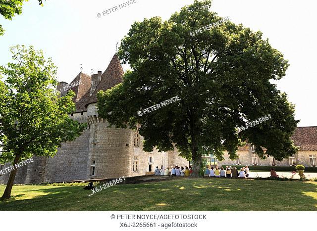 A group of tourists rest outside the Chateau de Monbazillac France