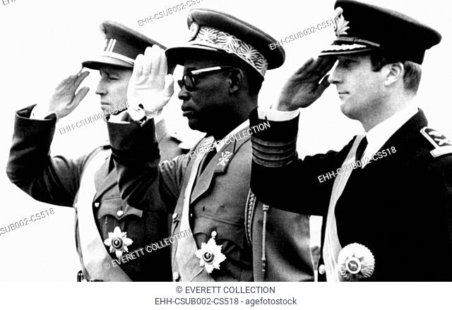 Congolese President Joseph Mobutu flanked by Belgian's King Baudouin (left) and Prince Albert. Nov. 3, 1969. It was the first official visit of a Congolese head...