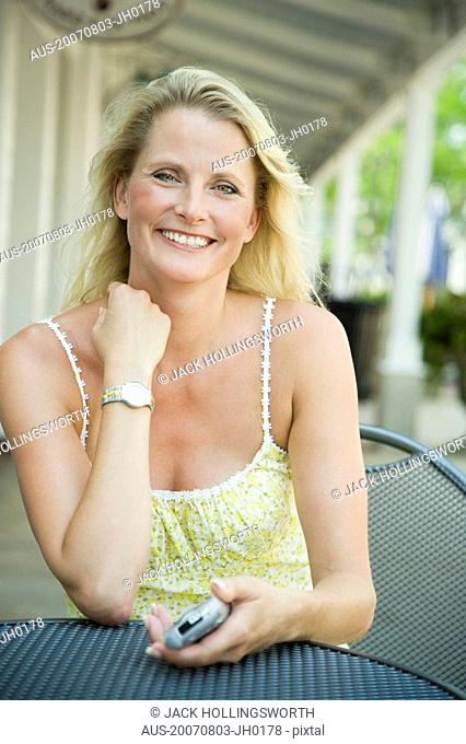 Portrait of a mature woman sitting in a cafe and smiling