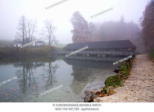 Wooden bridge across lake Koenigssee in the morning mist, Schoenau am Koenigssee, Berchtesgaden Nation Park, Berchtesgadener Land, Upper Bavaria, Bavaria
