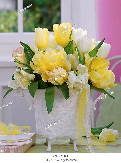 Tulips in white embossed vase
