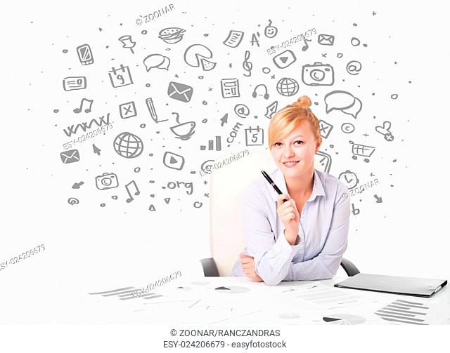 Young businesswoman with all kind of hand-drawn media icons in background