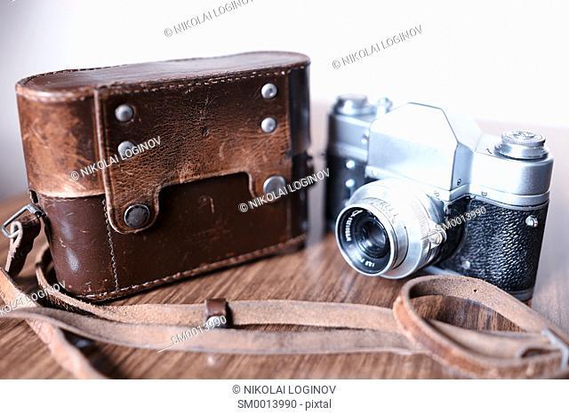 Vintage rangefinder camera with leather cover case background