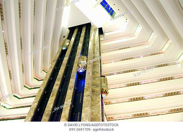 The Sheraton Grand Doha Resort and Convention Hotel on the Corniche in West Bay, Doha, Qatar. Elevators in the central atrium