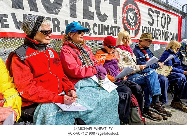 Protesters including senior citizens await arrest for blocking access to Kinder Morgan Oil Pipeline terminal, Burnaby, British Columbia, Canada