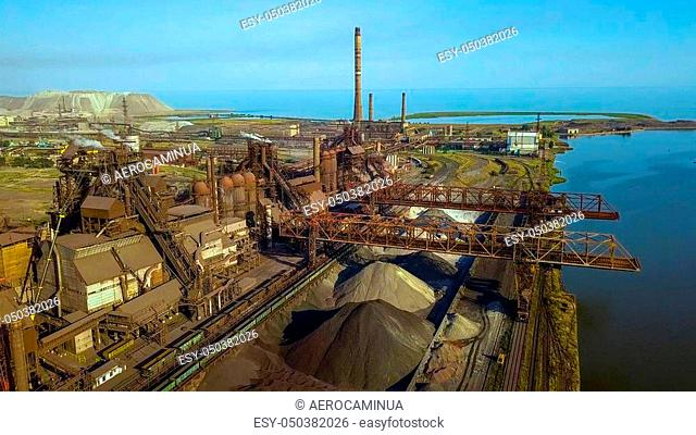 Aerial view of industrial steel plant. Aerial sleel factory. Flying over smoke steel plant pipes. Environmental pollution. Smoke