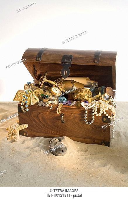 Wooden chest overflowing with treasure