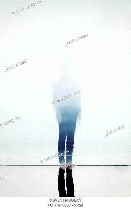 Woman reflecting on floor