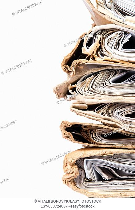 Old Covers Files Arranged In Chaotic Stack Isolated On White Background