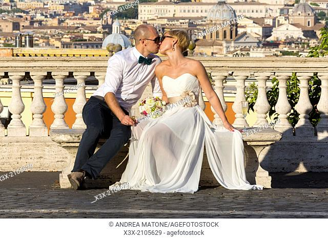 Newlyweds overlooking the city of Rome, Italy