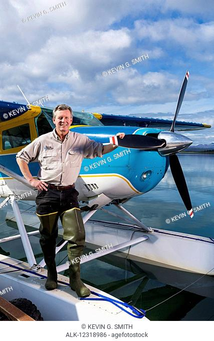 Tikchik Narrows Lodge owner, Bud Hodson, standing in front of one of his float planes, Tikchik Lake, Wood-Tikchik State Park, Southwestern Alaska, USA