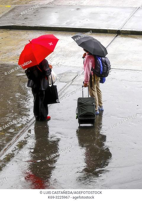 Travelers on a Rainy Morning. Berne. Switzerland