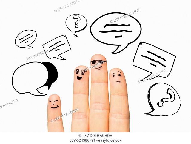 communication, family, people and body parts concept - close up of four fingers with different facial expressions and text clouds