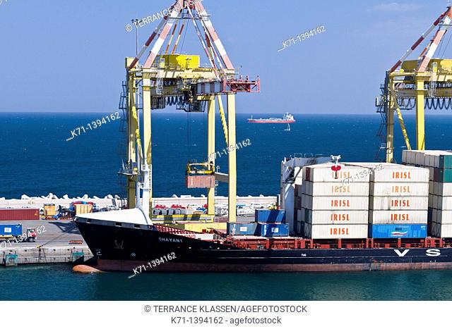 Loading a container ship in Port Sultan Qaboos in the city of Muscat Oman