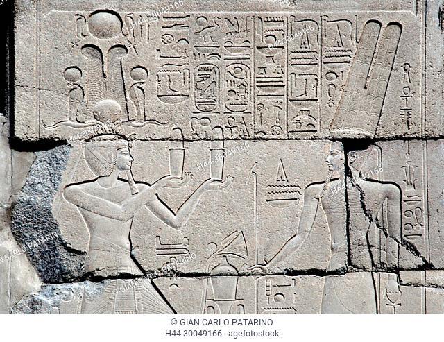 Karnak, Luxor, Egypt. Temple of Karnak sacred to god Amon: the pharaoh Horemheb offers to god Amon in the X° pylon