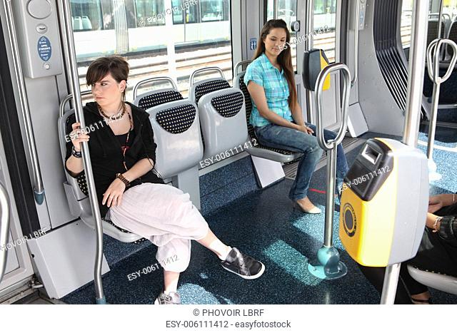 Two girls riding the tram