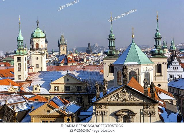 Towers and rooftops of Old Town, St. Salvator Church and Clementinum, Prague, Czech Republic