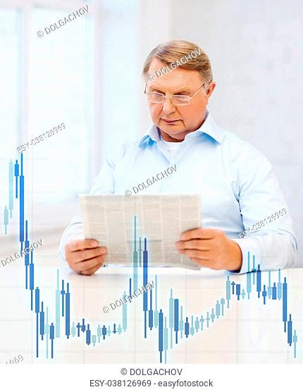 oldness, news, money and happiness concept - old man at home with newspaper and forex chart