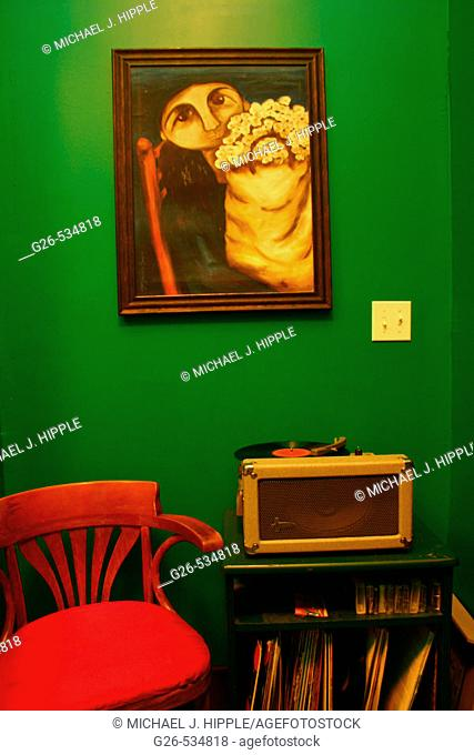 Old record player and chair in room