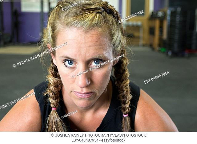 Female looking at the camera during a workout in a gym